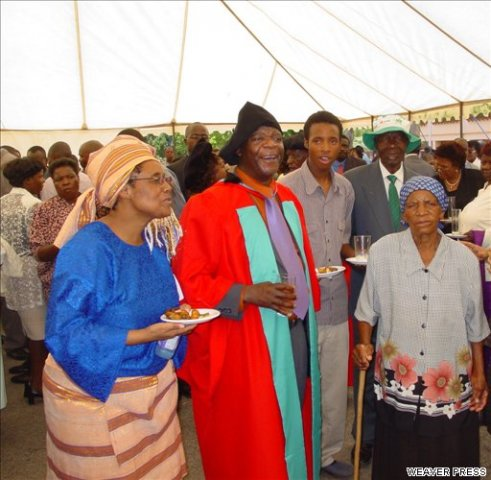Dr. Charles Mungoshi accompanied by his family having received his honorary an honorary doctorate from the University of Zimbabwe. 2003